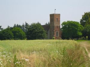 A picture of St Peters Carlton from across the fields at Carlton Park