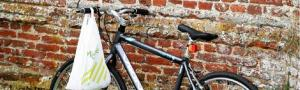 A bicycle leans against a church wall heralding the annual Ride and Stride around Suffolk's historic Churches
